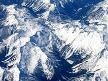 Rocky Mountains from the sky. Abord a jet plane Stock Images