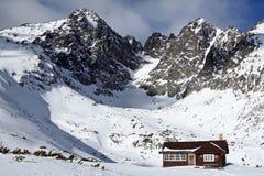 Rocky mountains (Slovakia, High Tatry). Rocky mountains with small wooden house (Slovakia, High Tatry royalty free stock images