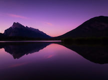 Rocky Mountains Sunrise Reflecting on Still Lake. The Rockies reflecting on Vermilion Lakes at Sunrise Stock Photo