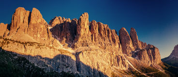 Rocky Mountains at sunset. Dolomite Alps Italy. Rocky Mountains at sunset. Dolomite Alps, Italy Stock Photo