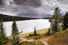 Rocky mountains and the two jack lake Stock Images