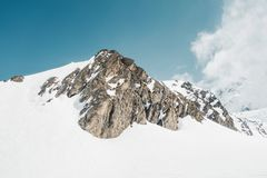 Rocky mountains under snow. On French alps, Val Thorens Stock Image