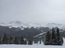 Cloudy Snow Covered Mountain Peaks. Snow capped Rocky Mountains at Winter Park, Colorado Stock Photos
