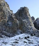 Rocky mountains of Zaili Alatau covered by snow. Winter scene of peaks in Kazakhstan Stock Image