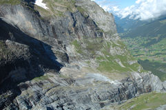 Rocky mountainside in valley nearby Grindelwald in Switzerland. Royalty Free Stock Photography