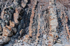 Rock face with cracks and fissures Royalty Free Stock Photo