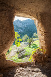 Rocky necropolis. Inside view of a rock-cut tomb in the necropolis of Pantalica in southeast Sicily stock photos