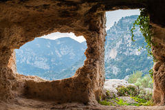 Rocky necropolis. Inside view of a rock-cut tomb in the necropolis of Pantalica in southeast Sicily stock image