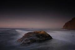 Rocky ocean coastline. Scenic view of rocky ocean coastline at twilight Royalty Free Stock Image