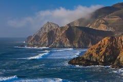 Rocky ocean coastline. Scenic view of waves breading on rocky ocean coastline under cloudscape Royalty Free Stock Photo