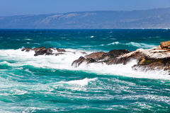 Rocky ocean coastline. Scenic view of waves breading on rocky ocean coastline Stock Image