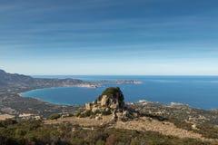 Rocky outcrop above Calvi Bay in Corsica Stock Image