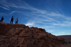 People admiring the Grand Canyon on top of the peak royalty free stock photography