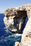 Rocky outcrop in the sea at Gozo Royalty Free Stock Image
