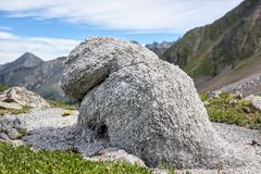 Rocky outcrop. Shape of stone is similar to figure animal. Rocky outcrop. Shape of stone is similar to figure of mythical animal. Photographed in mountains of Stock Photography