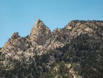 Rocky Outcrop on Shelf Road. Image of a couple of rocky, jagged peaks, on one of the mountains, while driving Shelf Road in Colorado. Taken Late Spring Early Stock Photos