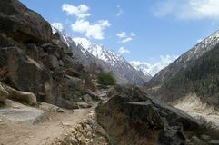 Rocky path. Footpath in the valley of Ganga river in Indian Himalayas. It leads to Gomukh glacier, source of Ganga Stock Image