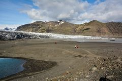 Rocky path to Skaftafellsjokull glacier with few unrecognisable. People, in Skaftafell, Iceland in summer Royalty Free Stock Image