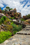 A rocky path up the hill among volcanic stones, Alicudi, Italy. Royalty Free Stock Photo