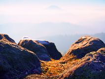 Rocky peak above inverse mist. Winter cold weather in mountains, colorful fog. Misty valley. In winter mountains. Peaks of mountains above creamy mist royalty free stock photos
