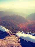 Rocky peak above inverse mist. Winter cold weather in mountains, colorful fog. Misty valley. In winter mountains. Peaks of mountains above creamy mist royalty free stock photo