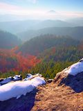 Rocky peak above inverse mist. Winter cold weather in mountains, colorful fog. Misty valley. In winter mountains. Peaks of mountains above creamy mist stock photos