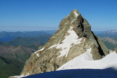 Rocky peak covered with snow Stock Image