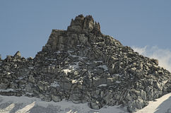Rocky peak with first snow Stock Image