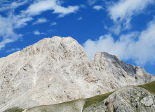 Rocky peak and green valley of Apennine Mountain Range in summer Royalty Free Stock Photos