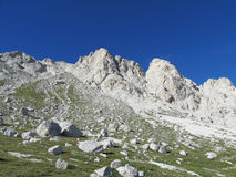 Rocky peak and green valley of Apennine Mountain Range in summer Royalty Free Stock Images