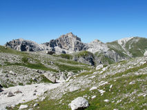 Rocky peak and green valley of Apennine Mountain Range in summer Stock Images