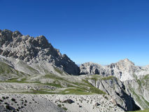 Rocky peak and green valley of Apennine Mountain Range in summer Stock Photo