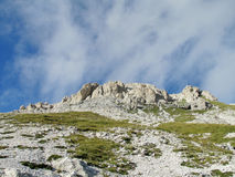 Rocky peak and green valley of Apennine Mountain Range in summer Stock Image