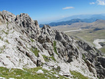 Rocky peak and green valley of Apennine Mountain Range in summer Royalty Free Stock Image