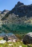 Rocky peak and Lake, Rila Mountain. Bulgaria Royalty Free Stock Image