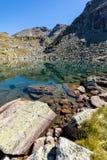 Rocky peak and Lake, Rila Mountain. Bulgaria Stock Photo