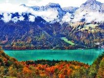 Rocky peak Mattlistock in the Glarus Alps mountain range and above Lake Klontalersee. Canton of Glarus, Switzerland stock photography