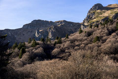 Rocky peak and mountains Stock Photo