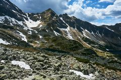 Rocky peaks and clouded sky royalty free stock photos