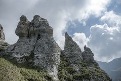 Rocky peaks among clouds in summer time. In Bucegi Mountains, Romania Stock Photo