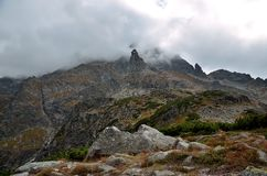 Rocky peaks in clouds Royalty Free Stock Image