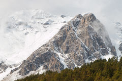 Rocky peaks covered by snow in the Alps Stock Photography