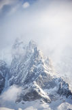 Rocky peaks covered with snow in French Alps Royalty Free Stock Images