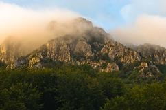 Rocky peaks at foggy sunrise, trekking path at Suva Planina mountain Stock Photos