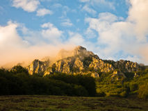 Rocky peaks at foggy sunrise, trekking path at Suva Planina mountain Royalty Free Stock Photos