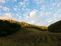 Rocky peaks at foggy sunrise, trekking path at Suva Planina mountain Stock Images