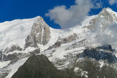 Rocky peaks and snow in the Alps. Rocky mountain peaks and snow in the Alps Stock Photo