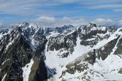 Rocky peaks of Tatra Mountains covered with snow Stock Photo