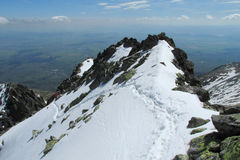 Rocky peaks of Tatra Mountains covered with snow Royalty Free Stock Images