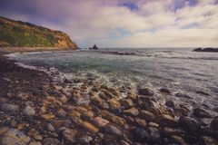 Rocky Pelican Cove Beach fotografie stock libere da diritti